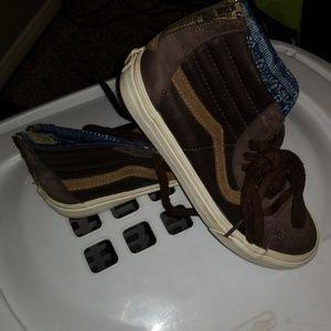 Dark brown and cream color high too vans